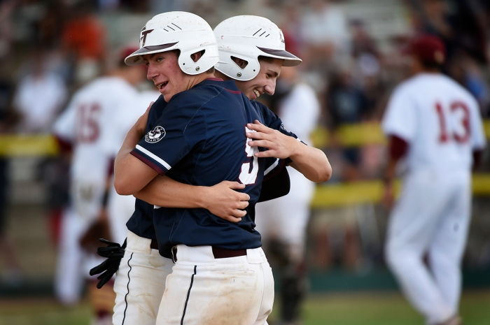 DENVER, CO - MAY 29: John-Michael Osley (15) and Matt Meraz (5) of Cherokee Trail celebrate during a time out after Osley hit an rbi double against Rocky Mountain during game two of the Class 5A high school baseball championship at All-City Field in Denver, Colorado on May 29, 2016. Cherokee Trail defeated Rocky Mountain 9-4 to win the Class 5A championship. (Photo by Seth McConnell/The Denver Post)